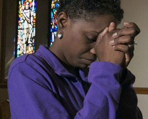 woman-praying-purple-shirt-425-111