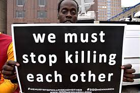 stop killing each other sign